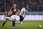 Andrea Poli of Bologna is pulled back by Diego Laxalt of Torino FC during the Serie A match at Stadio Grande Torino, Turin. Picture date: 12th January 2020. Picture credit should read: Jonathan Moscrop/Sportimage