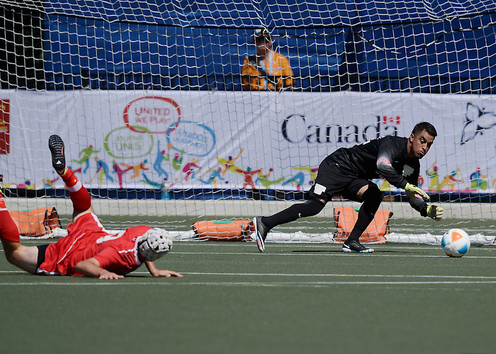 Toronto, ON - Aug 9 2015 -  Trevor Stiles of Cananda has a shot stopped by Marthell Vazquez of the United States in Football 7-a-side at the Parapan Am Fields during the Toronto 2015 Parapan American Games  (Photo: Matthew Murnaghan/Canadian Paralympic Committee)