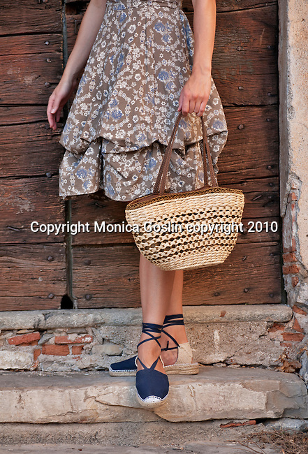 Straw bag from Bellagio, Italy with navy blue espadrilles