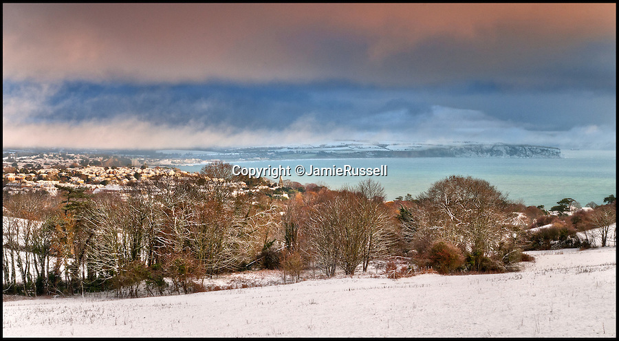 BNPS.co.uk (01202 558833)<br /> Pic: JamieRussell/BNPS<br /> <br /> ***Please Use Full Byline***<br /> <br /> Snow covers the town of Shanklin and Culver.<br /> <br /> Stunning photographs have revealed a turbulent side to the normally genteel Isle of Wight.<br /> <br /> The seemingly benign south coast holiday destination has been catalogued over a stormy year by local photographer Jamie Russell, and his astonishing pictures reveal the dramatic changes in weather that roll across the UK in just 12 months.<br /> <br /> Lightning storms, ice, floods, gales and blizzards have all been captured by the intrepid photographer who frequently got up in the middle of the night to capture the climatic chaos.<br /> <br /> Looking at these pictures prospective holidaymakers could be forgiven for thinking twice about a gentle staycation on the south coast island.