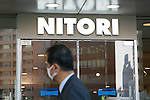 A man walks past the new Nitori department store in Shinjuku's Takashimaya Times Square on December 9, 2016, Tokyo, Japan. Nitori Holdings opened the new furniture and home accessory store in the South Hall of Tokyo's Takashimaya Times Square commercial complex on December 1st. The company plans to increase the number of its stores to 2000 overseas and 1000 in Japan by 2032. (Photo by Rodrigo Reyes Marin/AFLO)