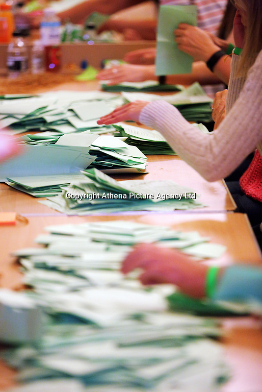 Pictured: Counters are going through ballots. Friday 09 June 2017<br />Re: Counting of ballots at Brangwyn Hall for the general election in Swansea, Wales, UK