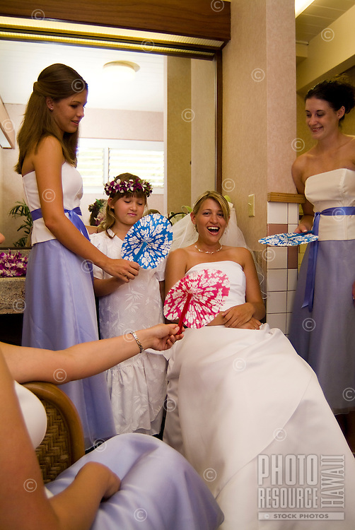 A bride relaxing with her wedding party before the wedding