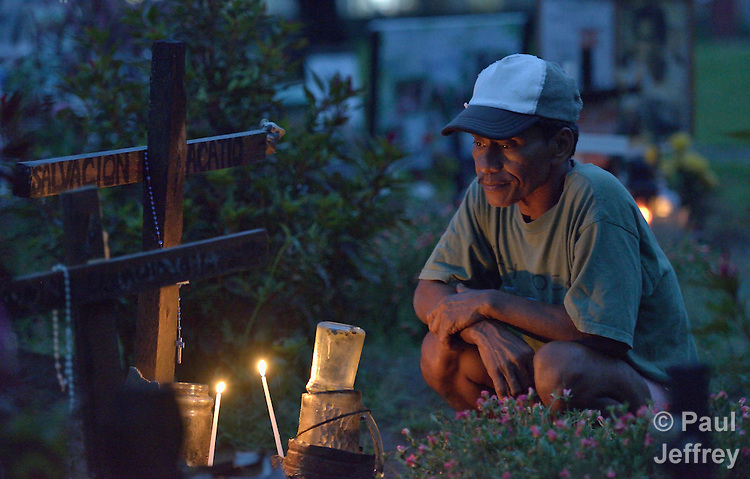 Pouldo Bacatio pauses to remember his grandmother Salvacion, who was buried in a common grave in a church yard in Palo, in the Philippines province of Leyte. She and thousands of others were killed by Typhoon Haiyan, known locally as Typhoon Yolanda.