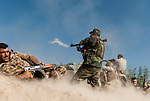 30/09/14  Iraq -- Daquq, Iraq -- A peshmerga fighter shoots RPG at the front line in Wahda village, Daquq during the heaviest fight in the area since the beginning of the war.
