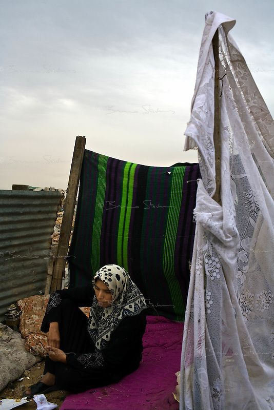 Jabalya, Gaza Strip, Jan 23 2009..Siham Abu Rachel, 34. her mother was killed when the Israeli army shelled their family home. Stunned inhabitants of Jabalya return to where their homes, farms and factories used to stand, only to find a huge rubble field, levelled by Israeli bombs, explosives and bulldozers. Not a wall is standing over a very large area on the eastern side of the village facing the israeli border..