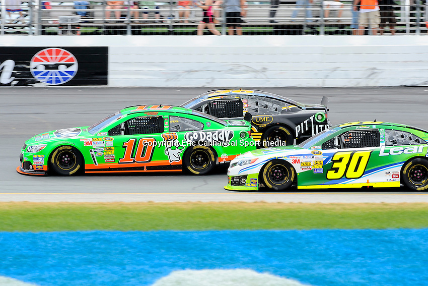 July 14, 2013 - Loudon, New Hampshire U.S. - Sprint Cup Series driver Danica Patrick (10) goes three wide with JJ Yeley (36) and David Stremme (30) during the NASCAR Sprint Cup Series Camping World RV Sales 301 held at the New Hampshire Motor Speedway in Loudon, New Hampshire.   Eric Canha/CSM
