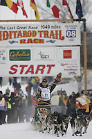 Jeff King waves to fans as he leaves the start line at the restart of the 2008 Iditarod in Willow