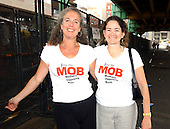 "Boston, MA - July 29, 2004 -- ""Moms Opposing Bush"" or ""The MOB"" show off their t-shirts outside the press entrance to the 2004 Democratic National Convention in Boston, Massachusetts on July 29, 2004.  Iris B. Krasnow, Founder (left) and Ginger Woolridge, President (right) claim to have 11,000 members.  Twenty-five to thirty percent of the members are Republicans and military moms..Credit: Ron Sachs / CNP"