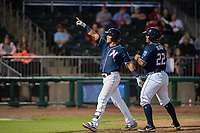 Northwest Arkansas Naturals infielder Angelo Castellano (16) (left) celebrates after hitting a home run on May 18, 2019, at Arvest Ballpark in Springdale, Arkansas. (Jason Ivester/Four Seam Images)