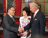 Washington, DC - July 7, 2009 -- United States Senator Al Franken (Democrat of Minnesota), left, shakes hands with Vice President Joseph Biden, right as he wife Franni, center looks on as he participates in a mock swearing-in ceremony in the Old Senate Chamber in the U.S. Capitol in Washington, D.C. on Tuesday, July 7, 2009.  .Credit: Ron Sachs / CNP