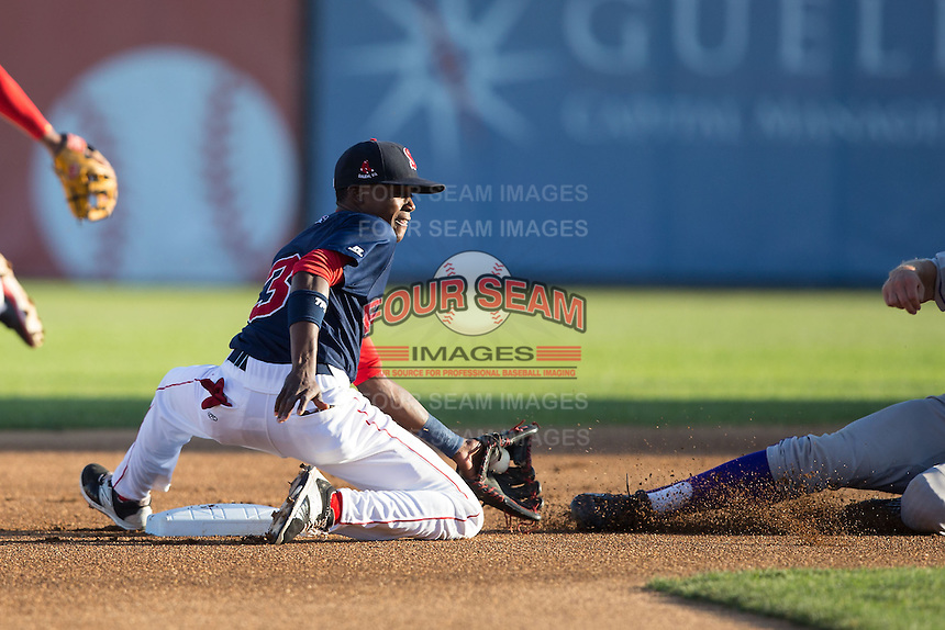 Salem Red Sox shortstop Jose Vinicio (3) fields a throw at second base during the game against the Winston-Salem Dash at LewisGale Field at Salem Memorial Ballpark on May 13, 2015 in Salem, Virginia.  The Red Sox defeated the Dash 8-2.  (Brian Westerholt/Four Seam Images)