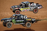 Apr 17, 2010; Surprise, AZ USA; LOORRS pro lite unlimited drivers Casey Currie (2) and Brian Deegan (38) take a jump alongside each other during round 3 at Speedworld Off Road Park. Mandatory Credit: Mark J. Rebilas-US PRESSWIRE.