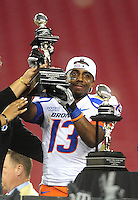 Jan. 4, 2010; Glendale, AZ, USA; Boise State Broncos cornerback (13) Brandyn Thompson celebrates with the MVP trophy following the game against the TCU Horned Frogs in the 2010 Fiesta Bowl at University of Phoenix Stadium. Boise State defeated TCU 17-10. Mandatory Credit: Mark J. Rebilas-