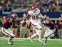 Hawgs Illustrated/Ben Goff<br /> Cheyenne O'Grady, Arkansas tight end, evades Derrick Tucker (left) and DeShawn Capers-Smith, Texas A&M defenders, in the 4th quarter Saturday, Sept. 29, 2018, during the Southwest Classic at AT&T Stadium in Arlington, Texas.