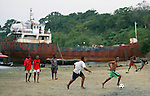 TANGA, TANZANIA - JULY 7:  Boys play football in a rural area outside of Tanga, Tanzania on July 7, 2010. Football is the most popular sport and pastime in Tanzania, and with the presence of the World Cup in South Africa the popularity of the sport has become contagious.