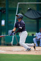 GCL Yankees West catcher Hemmanuel Rosario (21) follows through on a swing during the second game of a doubleheader against the GCL Braves on July 30, 2018 at Champion Stadium in Kissimmee, Florida.  GCL Braves defeated GCL Yankees West 5-4.  (Mike Janes/Four Seam Images)