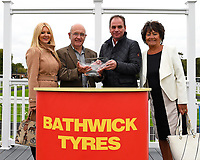 Connections of Edge receive their trophy from sponsors after winning The Bathwick Tyres Handicap (Div 2)   during Bathwick Tyres Reduced Admission Race Day at Salisbury Racecourse on 9th October 2017