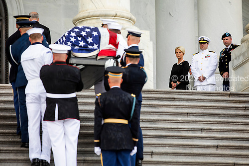 John McCain's widow Cindy McCain (C), and his sons Jack (C-L) and James (R) watch joint service members of a military casket team carry the casket of Senator John McCain into the US Capitol, where he will lie in state for the rest of the day in Washington, DC, USA, 31 August 2018. McCain died 25 August, 2018 from brain cancer at his ranch in Sedona, Arizona, USA. He was a veteran of the Vietnam War, served two terms in the US House of Representatives, and was elected to five terms in the US Senate. McCain also ran for president twice, and was the Republican nominee in 2008.