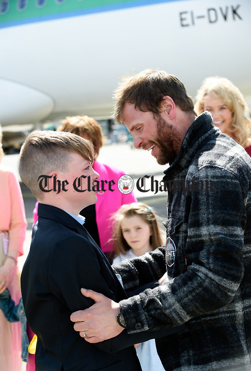 John Burke meets his nephew, an emotional Callum Curtin, on his arrival back to Shannon Airport, following his successful attempt, being the first Clare person ever to climb Mount Everest. Photograph by John Kelly.