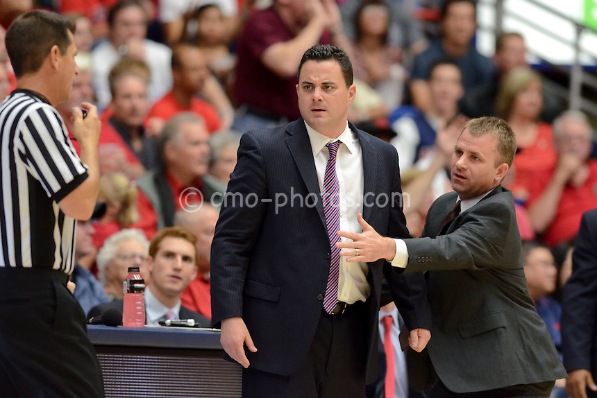 Nov 23, 2011; Tucson, AZ, USA; Arizona Wildcats head coach Sean Miller is restrained by assistant coach James Whitford while Miller yells at an official in the first half of a game against the San Diego State Aztecs at the McKale Center.  Mandatory Credit: Chris Morrison-US PRESSWIRE