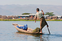 Myanmar, Burma.  Young Man Rowing with One Leg, in the Style Common to Inle Lake, Shan State.