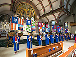 Students holding the individual flags for DePaul's colleges and schools stand inside the Saint Vincent de Paul Parish Church on DePaul University's Lincoln Park Campus for the annual Baccalaureate Mass Friday, June 9, 2017. The event was part of the 119th commencement ceremonies for the Chicago university. (DePaul University/Jamie Moncrief)