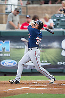 Alex Kirilloff (30) of the Elizabethton Twins follows through on his swing against the Pulaski Yankees at Calfee Park on July 25, 2016 in Pulaski, Virginia.  The Twins defeated the Yankees 6-1.  (Brian Westerholt/Four Seam Images)