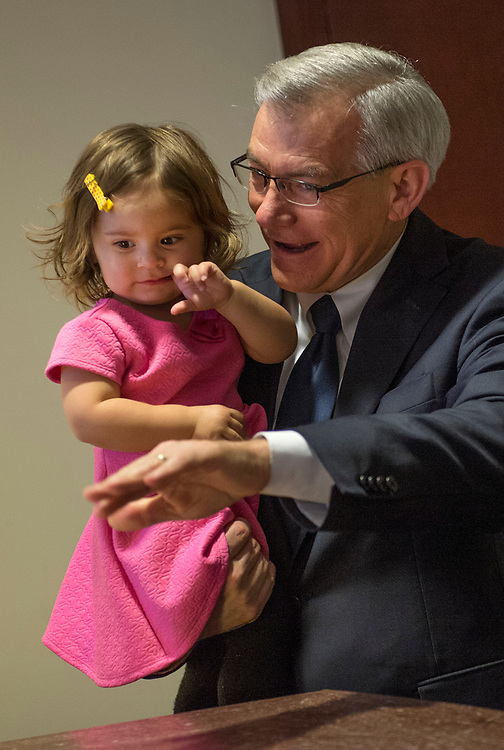 UNITED STATES - APRIL 6: Rep. David Schweikert, R-Ariz., holds his daughter, Olivia, after a news conference with members the GOP caucus in the Capitol Visitor Center to announce a new amendment to the health care bill to repeal and replace the ACA, April 6, 2017. (Photo By Tom Williams/CQ Roll Call)