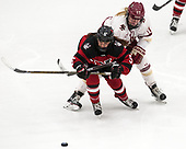 Halle Silva (NU - 5), Delaney Belinskas (BC - 17) -  The Boston College Eagles defeated the Northeastern University Huskies 2-1 in overtime to win the 2017 Hockey East championship on Sunday, March 5, 2017, at Walter Brown Arena in Boston, Massachusetts.