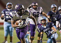Arkansas Democrat-Gazette/MELISSA SUE GERRITS - 12/05/15 -  Fayetteville's Javonte Smith looks over his shoulder while running into the end zone for the team's last touchdown, a 31 yard run in the 4th quarter during their game against Har-Ber in during the 7A Championship game December 5, 2015 at War Memorial Stadium in Little Rock.