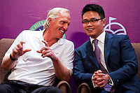 HAIKOU, CHINA - OCTOBER 27:  (L-R) Golf legend Greg Norman of Australia and Dr. Ken Chu, Vice Chairman of Mission Hills Group laugh during the opening press conference of the Mission Hills Star Trophy on October 27, 2010 in Haikou, China. The Mission Hills Star Trophy is Asia's leading leisure liflestyle event and features Hollywood celebrities and international golf stars.  Photo by Victor Fraile / studioEAST