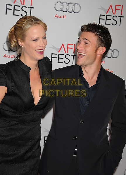 "Alison Eastwood & Scott Eastwood.AFI Fest 2011 Opening Night Gala Premiere of ""J. Edgar"" held at Grauman's Chinese Theatre, Hollywood, California, USA..November 3rd, 2011.full length black low cut neckline cleavage dress suit jacket profile silver half-brother sister.CAP/ROT/TM.©Tony Michaels/Roth Stock/Capital Pictures"