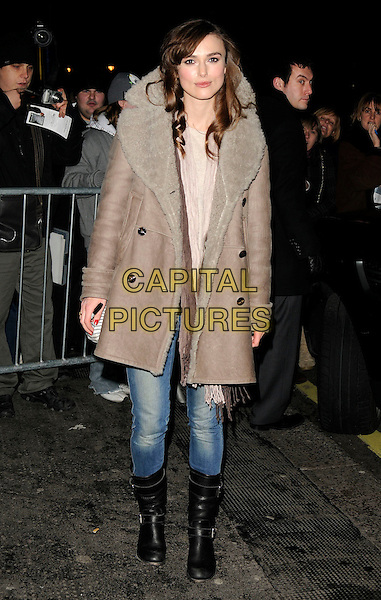 "KEIRA KNIGHTLEY .leaves after her evening performance of ""The Misanthrope"", ComedyTheatre, London, England, UK, .4th January 2010 .full length brown grey gray sheepskin coat jeans knee high black boots bag scarf brown.CAP/CAN.©Can Nguyen/Capital Pictures."