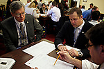 Congressman-elect Jim Bridenstine, from Oklahoma's First District, center, makes decisions about his future office, with his chief of staff Joe Kaufman, left, in the Rayburn House Office Building in Washington, DC on Nov. 30, 2012.