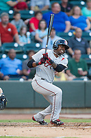 LeVon Washington (4) of the Carolina Mudcats follows through on his swing against the Winston-Salem Dash at BB&T Ballpark on June 6, 2014 in Winston-Salem, North Carolina.  The Mudcats defeated the Dash 3-1.  (Brian Westerholt/Four Seam Images)