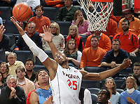 Virginia forward Akil Mitchell (25) reaches for a rebound during the game against North Carolina at the John Paul Jones arena in Charlottesville, Va. Virginia defeated North Carolina 61-52.