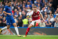 Shkodran Mustafi of Arsenal clears from Pedro of Chelsea during the Premier League match between Chelsea and Arsenal at Stamford Bridge, London, England on 17 September 2017. Photo by Andy Rowland.