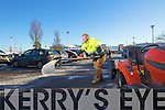 Dave Davis spreading salt to clear ice in the car park at Manor West, shopping centre, Tralee.