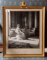 BNPS.co.uk (01202 558833)<br /> Pic: PhilYeomans/BNPS<br /> <br /> The house is full of Royal momento's, Cecil Beaton photograph of the Queen Mother.<br /> <br /> A remarkable 'timewarp' archive amassed by a dressmaker to the Queen has sold for over £100,000.<br /> <br /> The late Ian Thomas meticulously kept his fashion designs, letters, cards and photographs relating to the Queen at his home that was more like a museum. <br /> <br /> He helped design the Queen's coronation gown in 1953 as well as the powder blue outfit she wore for Charles and Diana's wedding in 1981.<br /> <br /> The lifelong bachelor passed away in 1993 and left his home and its contents to a florist he had been good friends with for 25 years.<br /> <br /> After she died in 2015 the property was inherited by a relative who also knew Mr Thomas well.<br /> <br /> She has now sold the contents at auction.
