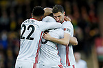 Enda Stevens of Sheffield United celebrates with team mates after scoring his sides first goal of the game during the Premier League match at Carrow Road, Norwich. Picture date: 8th December 2019. Picture credit should read: James Wilson/Sportimage