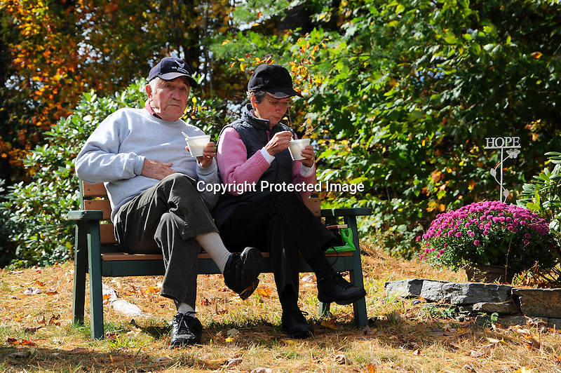 Couple Enjoying Lunch on a Park Bench on a Sunny Fall Day in New Hampshire USA