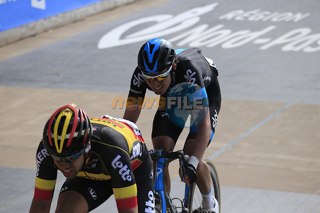 Jens Debusschere (BEL) Lotto-Soudal and Luke Rowe (GBR) Team Sky enter the famous Roubaix Velodrome at the end of the 113th edition of the Paris-Roubaix 2015 cycle race held over the cobbled roads of Northern France. 12th April 2015.<br /> Photo: Eoin Clarke www.newsfile.ie