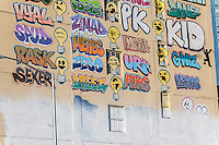 The Five Pointz building in Long Island City in Queens in New York, once covered in graffiti artwork, on Tuesday, November 19, 2013. The 200,000 square foot outdoor art exhibit space has been painted over on Monday night in anticipation o being demolished. The owner, Jerry Wolkoff,  won in court and staved off an injunction so that the building could be demolished and the site developed. The building, called a graffiti mecca, was a major tourist attraction in Queens.  (© Richard B. Levine)