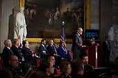 Senate Minority Leader Chuck Schumer, a Democrat from New York, speaks during a congressional Gold Medal ceremony for former Senator Bob Dole, in Washington D.C., U.S., on Wednesday, Jan. 17, 2018. From left: U.S. Vice President Mike Pence, U.S. President Donald Trump, former Senator Bob Dole, U.S. House Speaker Paul Ryan, a Republican from Wisconsin, Senate Majority Leader Mitch McConnell, a Republican from Kentucky, and House Minority Leader Nancy Pelosi, a Democrat from California. Photographer: Al Drago/Bloomberg<br /> Credit: Al Drago / Pool via CNP