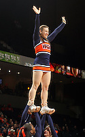 Virginia  cheerleaders perform during an NCAA college basketball game in Charlottesville, Va. Duke defeated Virginia 62-41...