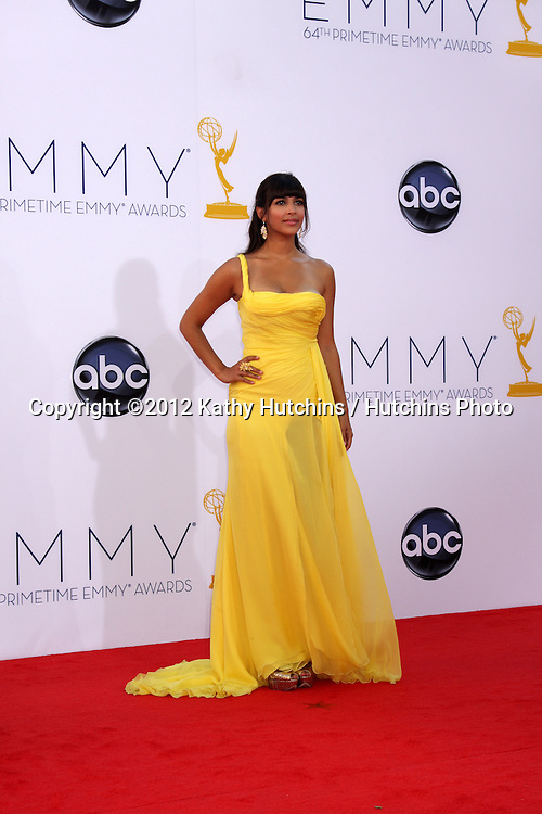 LOS ANGELES - SEP 23:  Hannah Simone arrives at the 2012 Emmy Awards at Nokia Theater on September 23, 2012 in Los Angeles, CA