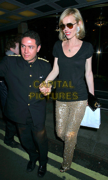 PORTER & EVA HERZIGOVA .Michael Kors boutique flagship store launch party dinner, China Tang, Dorchester Hotel , London, England. .April 27th, 2009 .full length sunglasses shades black top gold sequins sequined trousers uniform holding hands goody bag tall short  funny.CAP/MEG.©Mega Pictures/Capital Pictures.