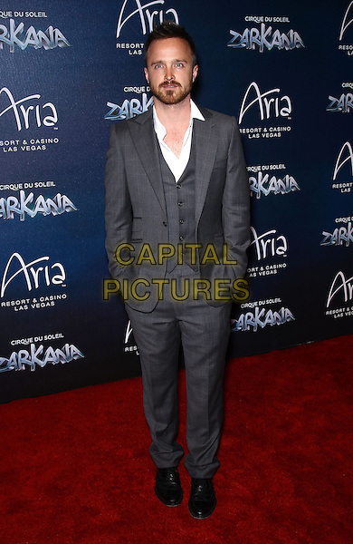 Aaron Paul.Red Carpet Premiere of Zarkana by Cirque Du Soleil at Aria Resort and Casino, Las Vegas, Nevada, USA, .9th November 2012..full length hands in pockets beard facial hair white shirt grey gray suit .CAP/ADM/MJT.© MJT/AdMedia/Capital Pictures.