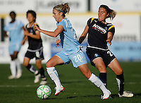 Kacey White (20) of Sky Blue FC gets past Camille Abily (20) of the Los Angeles Sol. The Los Angeles Sol defeated Sky Blue FC 2-0 during a Women's Professional Soccer match at TD Bank Ballpark in Bridgewater, NJ, on April 5, 2009. Photo by Howard C. Smith/isiphotos.com